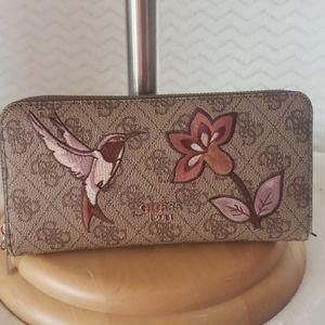 Guess humming bird zip around wallet.